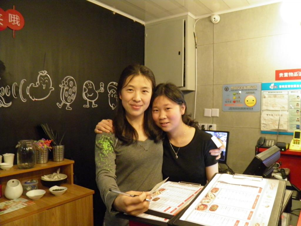 Laolaio restaurant Shanghai. Anna (on left)